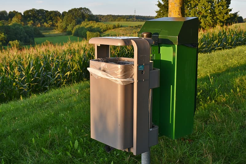 Two gray and green mailboxes