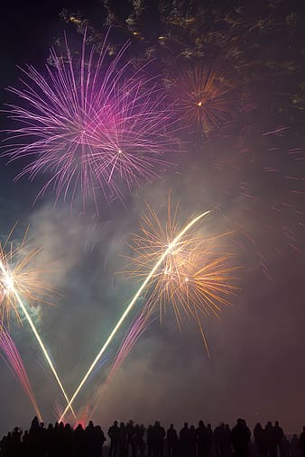 Pink and yellow fireworks display