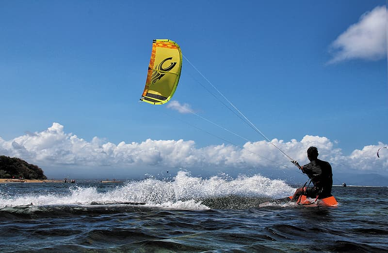 Man on body of water while kite boarding