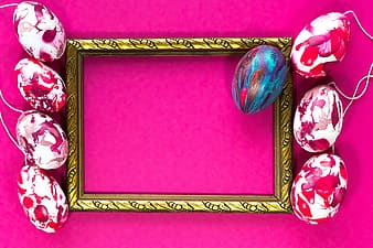 Gold framed mirror on purple textile