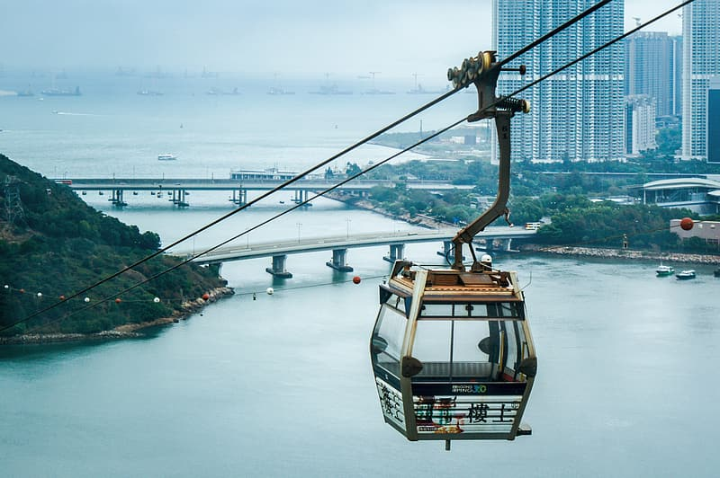 Brown and gray cable car above sea