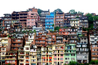 Panoramic photography of multicolored concrete buildings under white sky