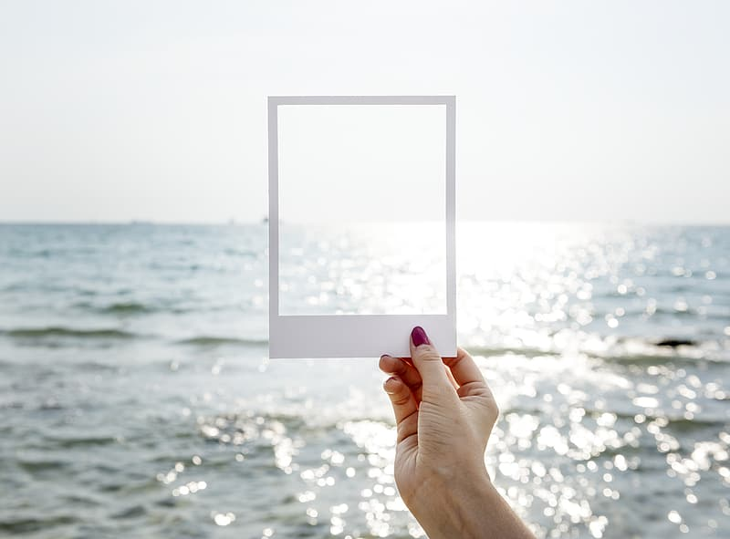 Empty photo border pointed at ocean