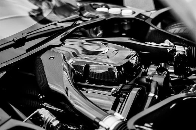 Grayscale photography of vehicle engine bay