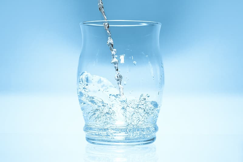 Water poured on clear drinking glass