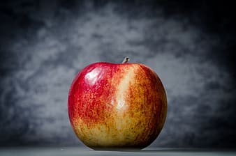 Red apple with gray background