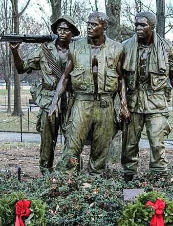 Three army men statue during daytime