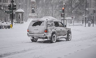 Grey SUV with snow cap
