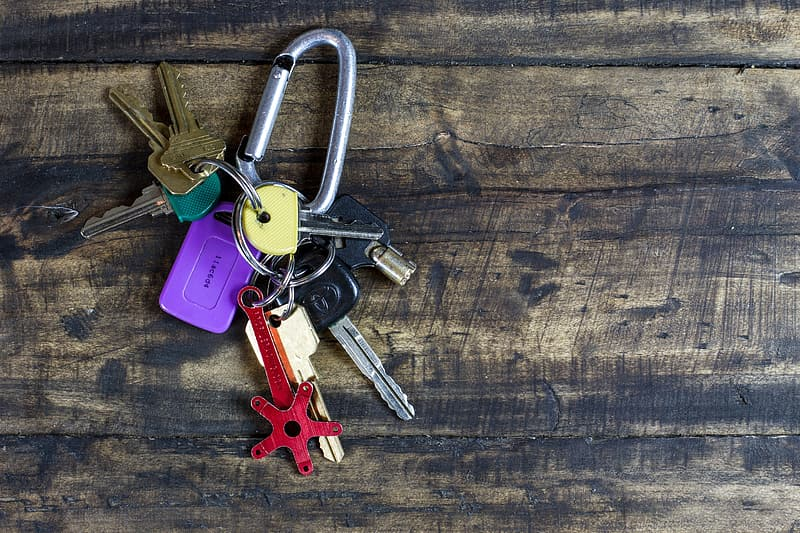 Key chain on brown wooden surface