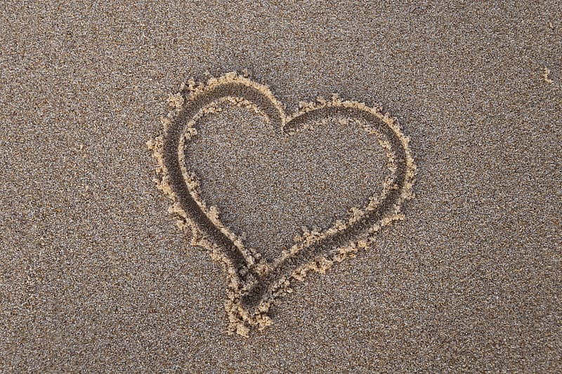 Heart shape in sand at daytime