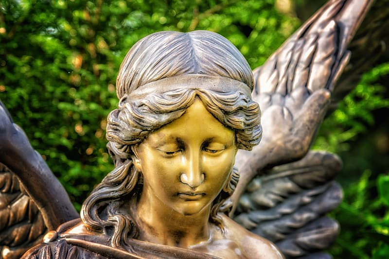 Brass-colored statue of angel
