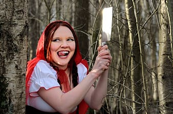Red riding hood on brown trees