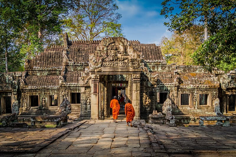 Monks walking through the temple during daytime
