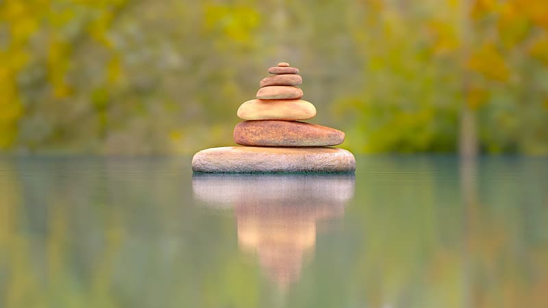 Brown stone stack on water