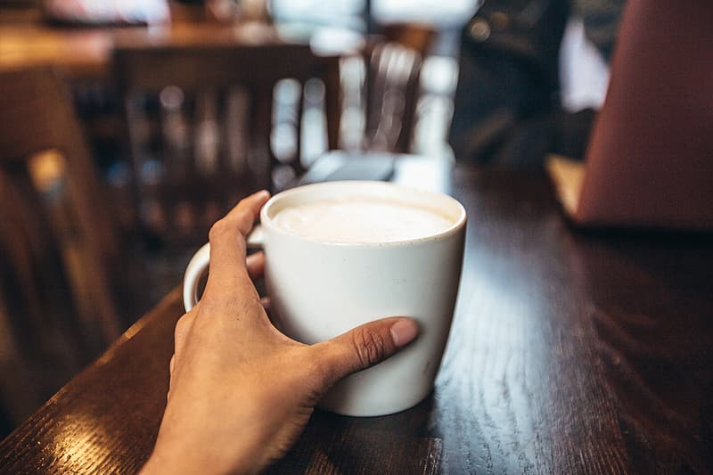 Cafe coffee cup being held in a hand