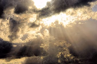 Perforated sun rays under cumulonimbus clouds