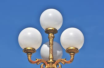 Gold and white lamp post