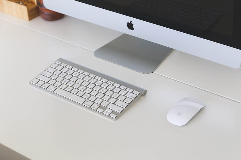 Magic Keyboard and Magic Mouse on white surface