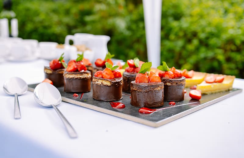 Chocolate cakes topped with strawberries
