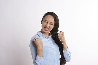 Woman in blue button up shirt smiling
