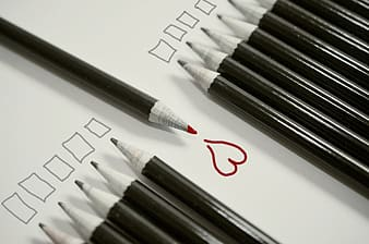 Pencils with red heartt drawing