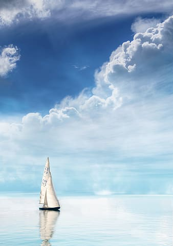 White sail boat on sea under blue sky and white clouds during daytime