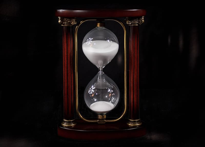 Photo of brown and clear hourglass