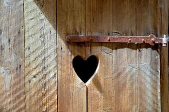 Heart-shaped brown wooden hole