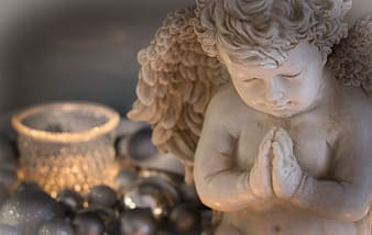 White angel ceramic figurine on black and brown beads