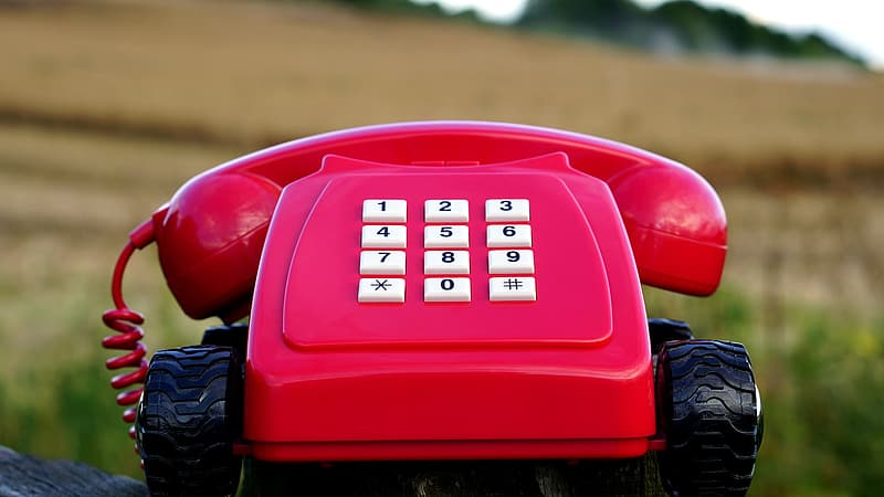 Red and white corded telephone
