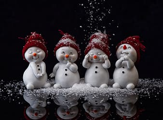 White ceramic snowman figurines with red and white santa hat