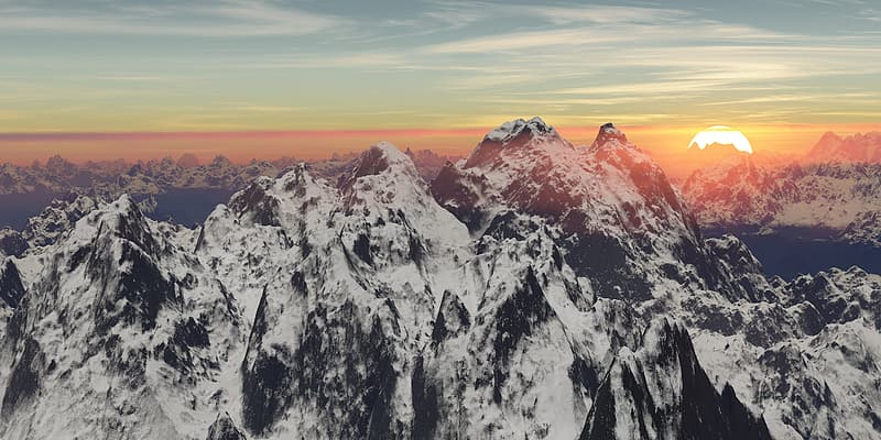 Snow-covered mountains under sunset