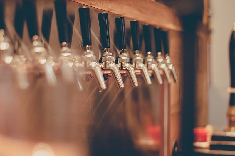 Silver and black beer taps