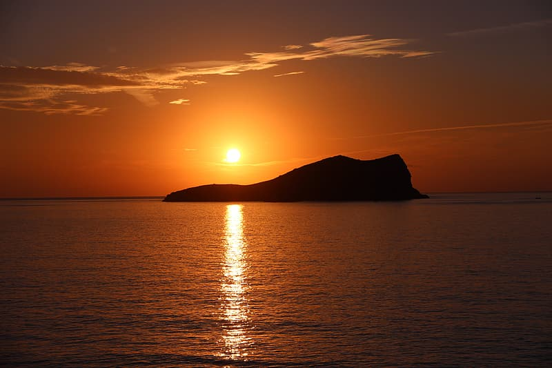 Silhouette of island during golden hour