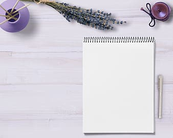White notebook with gray ballpoint pen