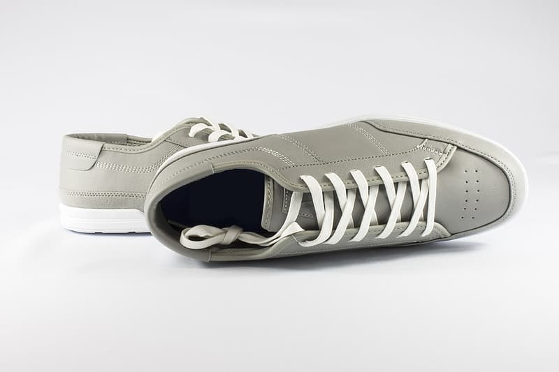 Pair of gray low-top sneakers on white surface