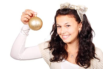 Woman holding gold bauble