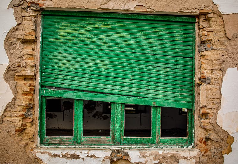 Almost closed green wooden window
