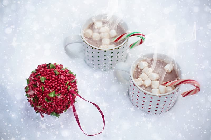 Two white ceramic mugs with filled with white marshmallows