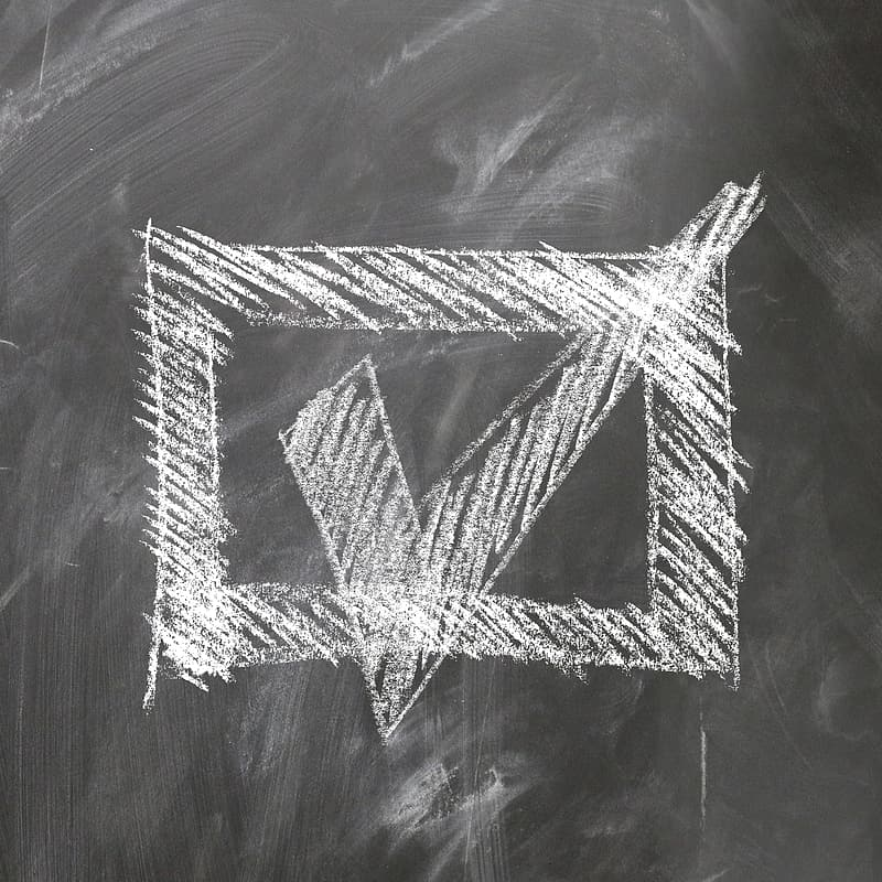 Photo of chalk drawn box with check