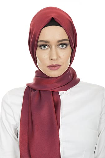 Woman in white top and red headscarf