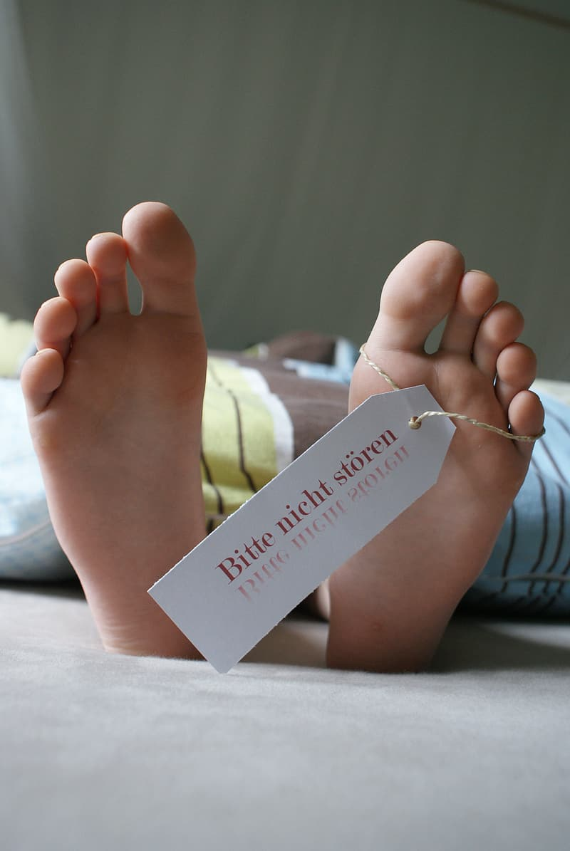 White tag on person's foot