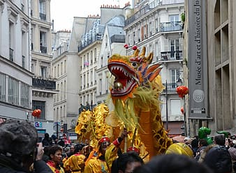 Dragon dance at the middle of high-rise buildings