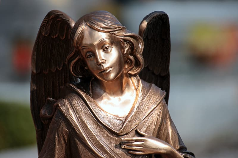 Brass angel statuette
