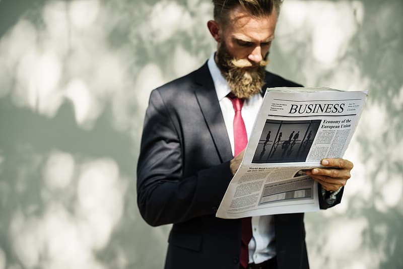 Man holding Business newspaper print
