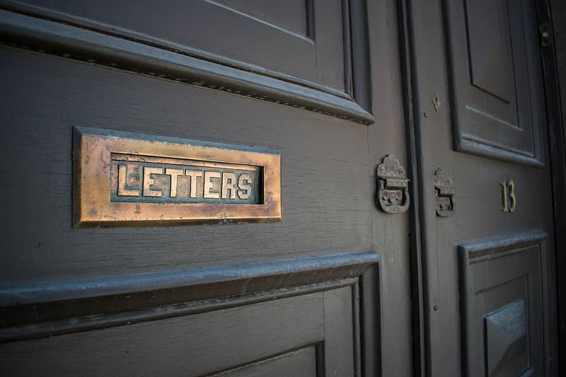Brown wooden door with letter hole