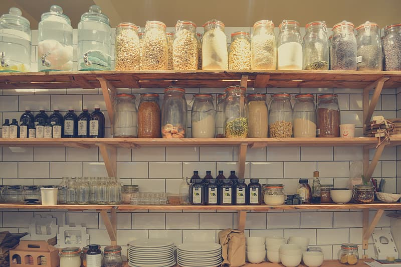 Jars on rack above plates and bowls