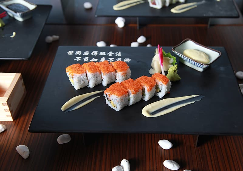 Sushi served on black plate