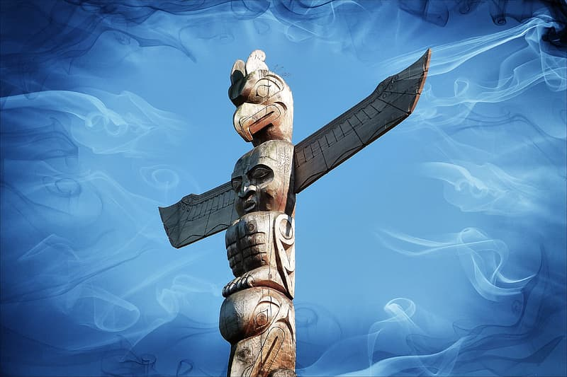 Brown wooden totem with blue background