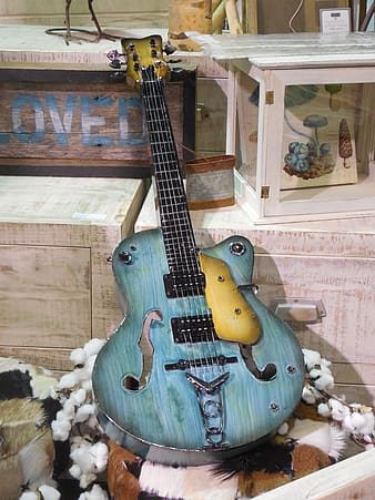 Blue wooden cut away guitar